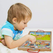 little boy in a striped shirt playing with the Four Seasons Magnetic Playset