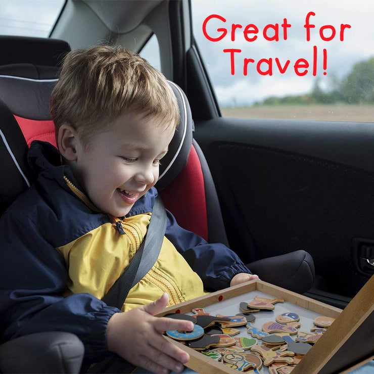 young boy travelling in a car and playing with the Four Seasons Magnetic Playset