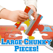 a toddlers hand holding a puzzle piece text reads large chunky pieces
