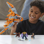 boy playing with his LEGO Marvel Super Heroes - Thanos: Ultimate Battle set