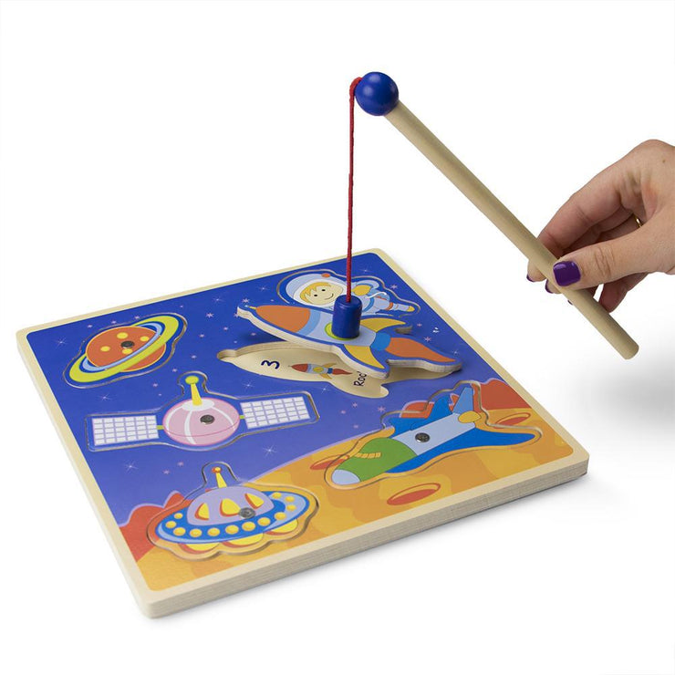 magnetic wand catching a rocket ship
