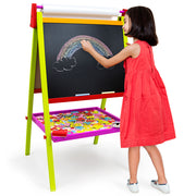 young girl in a dress drawing a rainbow on the chalkboard