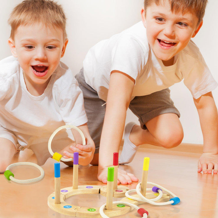 two boys playing happily with the Make Your Own Ring Toss Game