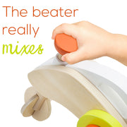 child's hand holding the mixer text reads beater really mixes