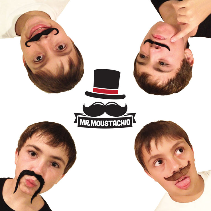 four men playing with the Mr. Moustachio's set wearing one each