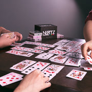 people at table playing Nertz: The Fast Frenzied Fun Card Game