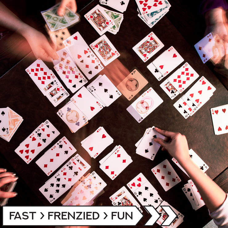birds eye view of people playing Nertz: The Fast Frenzied Fun Card Game
