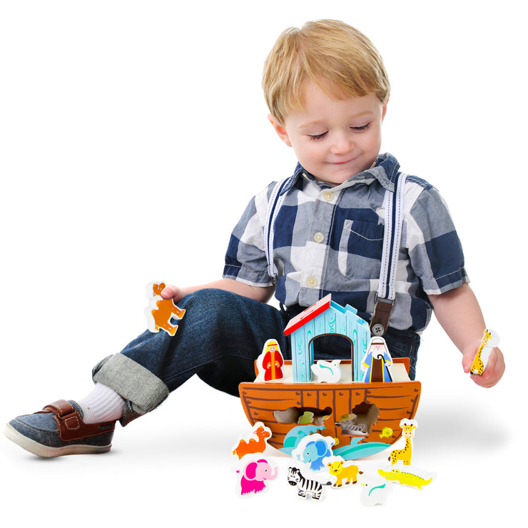 boy smiling playing with the Noah's Ark Playset