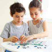 two kids playing with the Numbers Bingo game