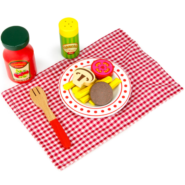 wood eats plate of pasta with condiments table cloth and fork