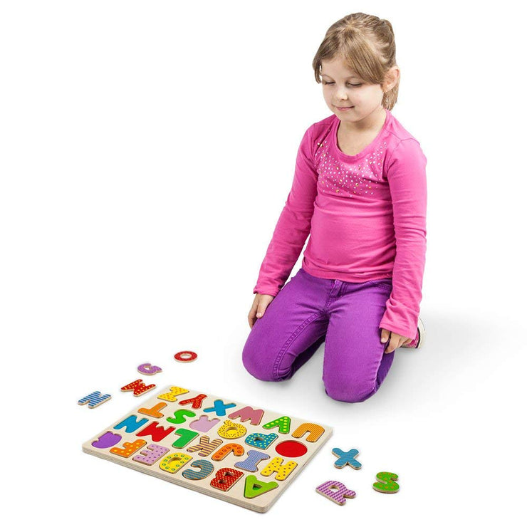 girl in pink playing with Wooden Alphabet Puzzle Board