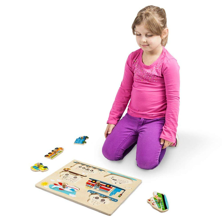 girl in pink kneeling by the Professor Poplar's Wooden People Movers Peg Puzzle