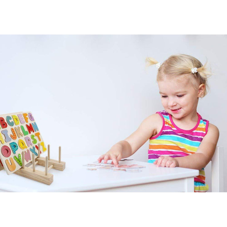 girl in rainbow top using the Professor Poplar's Wooden Puzzle Display Stand