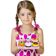 girl holding wood eats cupcakes