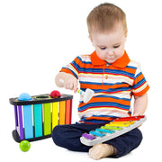 boy in stripy top playing with the Space Adventure Pound & Tap Bench