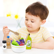 young boy playing with wood eats salad and condiments