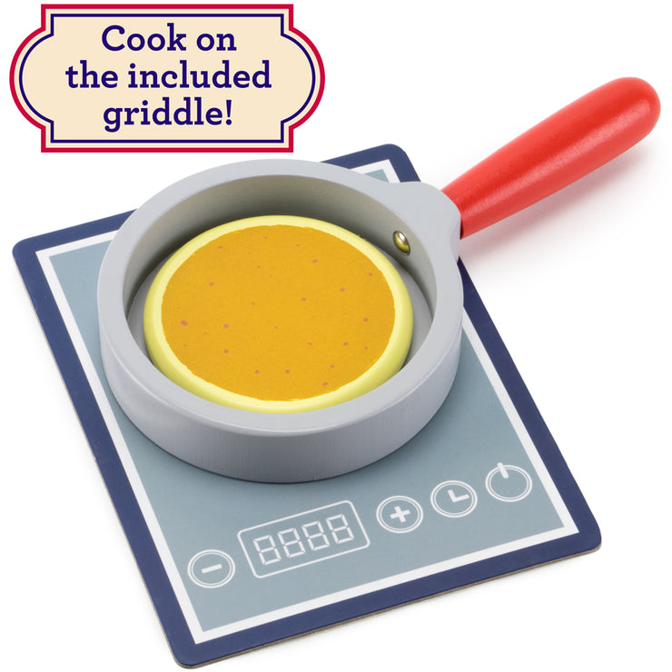 close up of a pancake in a frying pan text reads cook on included griddle