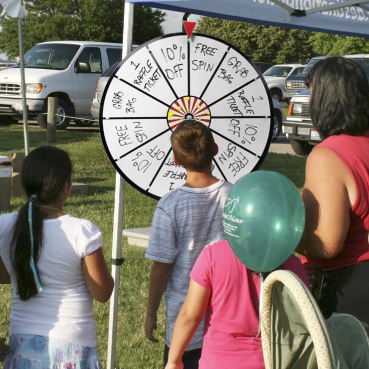 children spinning the prize wheel at a fair
