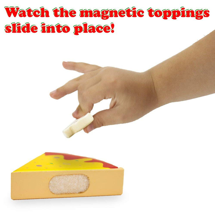 child's hand placing a topping on the wood eats pizza