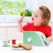 little girl in red playing with wood eats pop up toaster play set