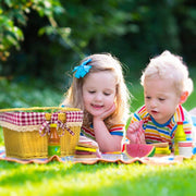 little boy and girl outside enjoying their wood eats picnic set