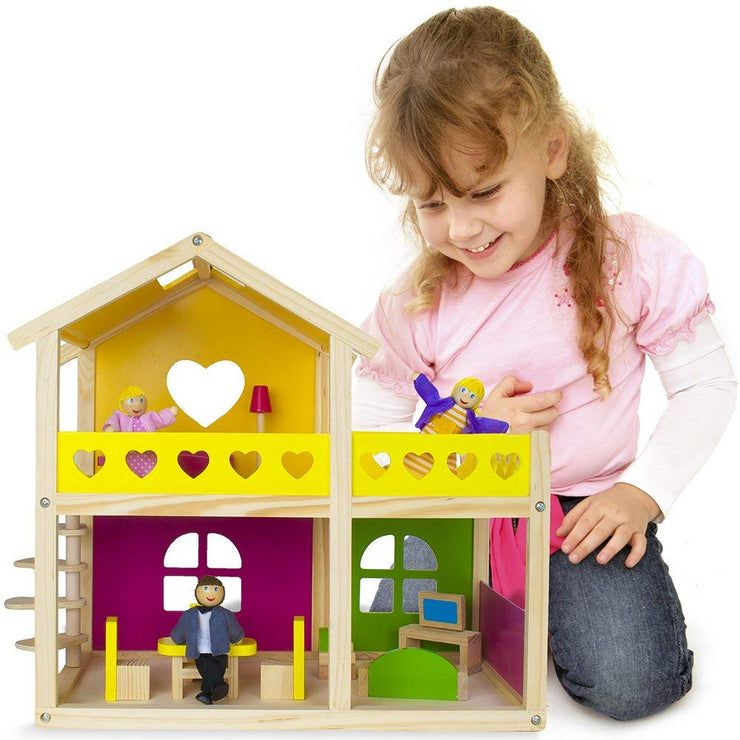 girl kneeling next to wooden wonders doll house