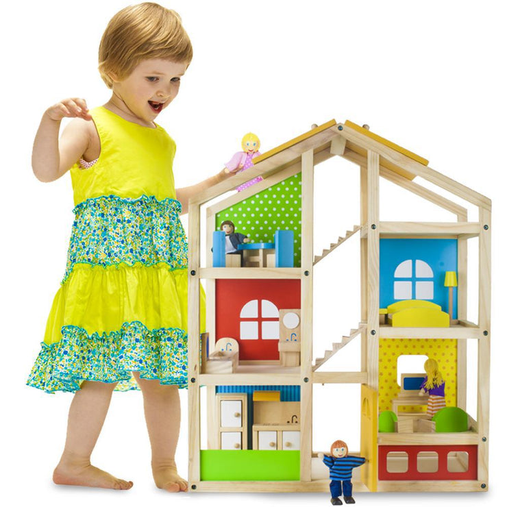 girl in yellow dress touching dolls house - STEM toys