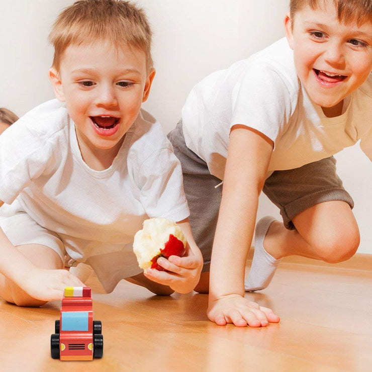 two boys playing with Wooden Wonders Put-It-Together Fire Engine
