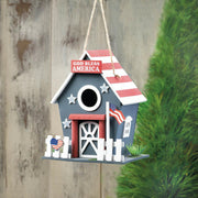 image of a bird house hanging from a tree