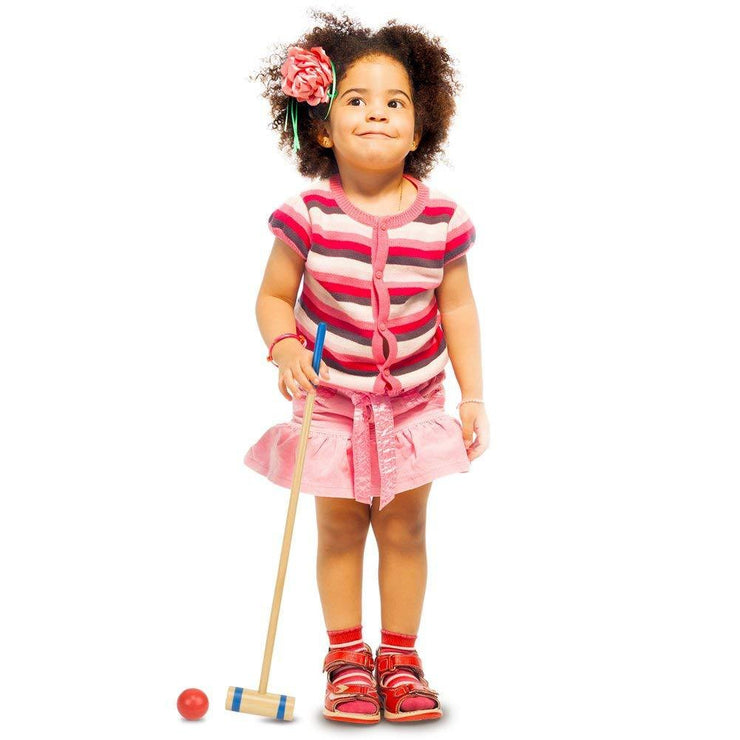 young girl with a mallet playing Jungle Croquet