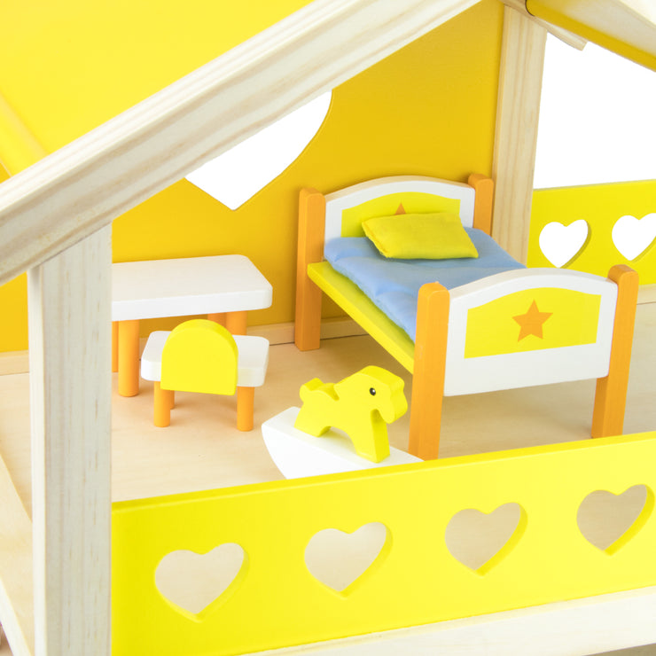 close up of Dreamland Children's Bedroom Furniture in a dollhouse