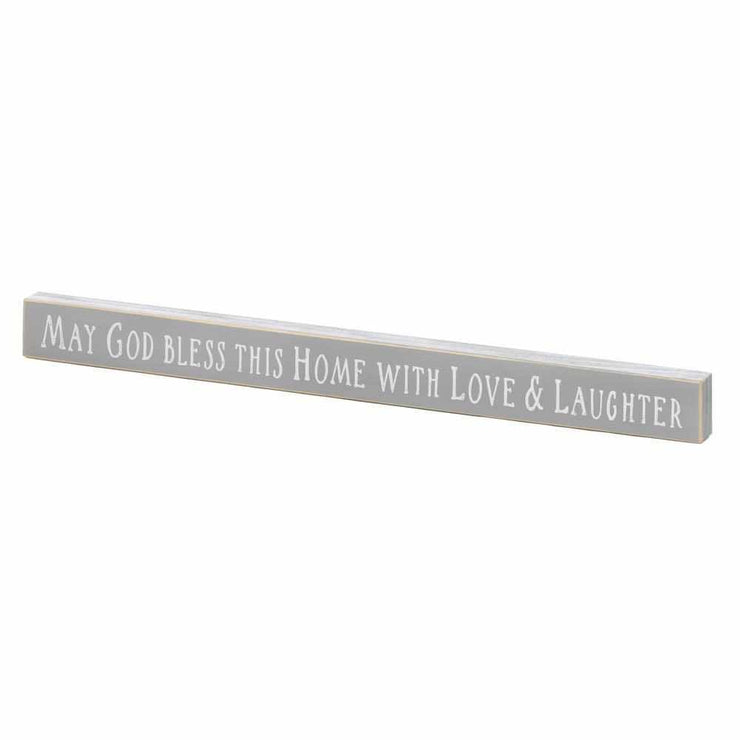 grey wooden sign reading may God bless this home with love and laughter