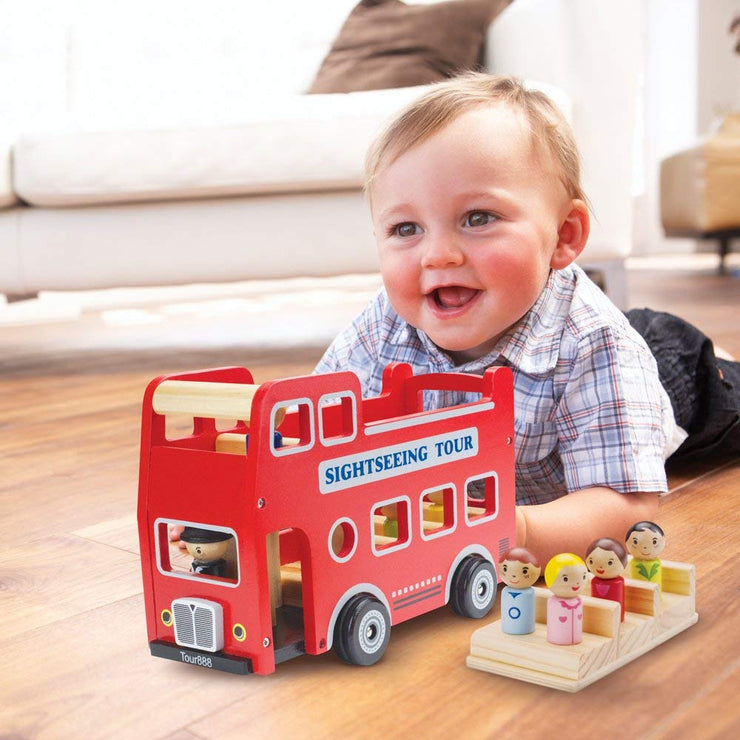 baby laughing playing with wooden wheels tour bus