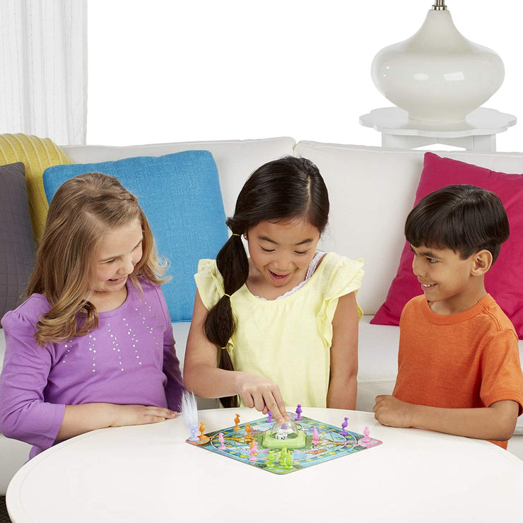 three kids playing with the DreamWorks Trolls in Trouble Game