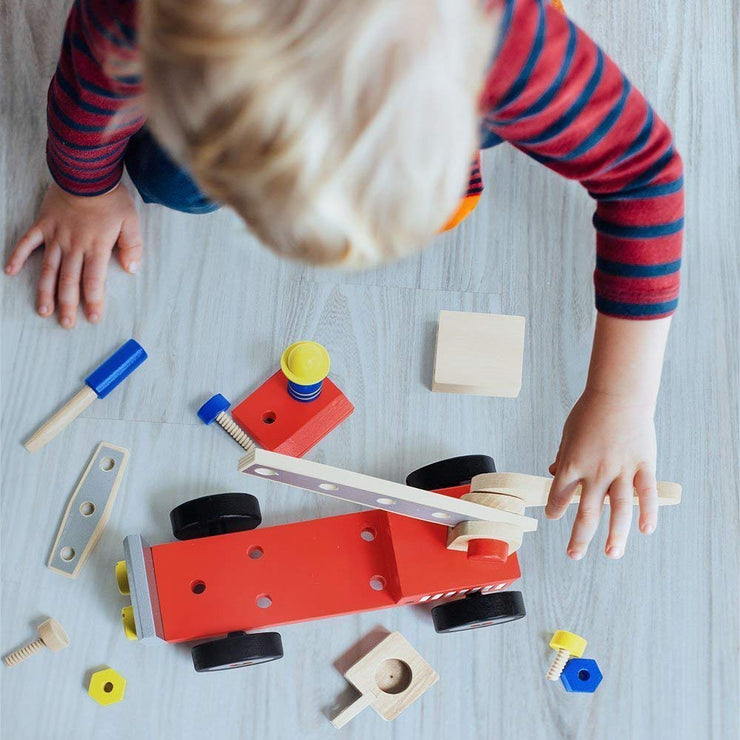aerial view of a boy playing with the DIY Wooden Fire Engine
