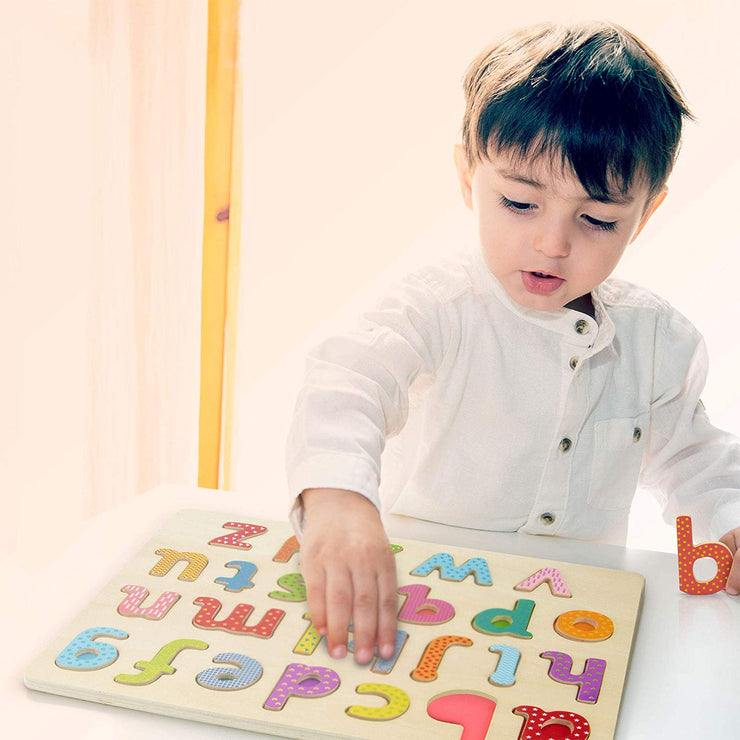 little boy playing with Professor Poplar Lower-case Alphabet Puzzle
