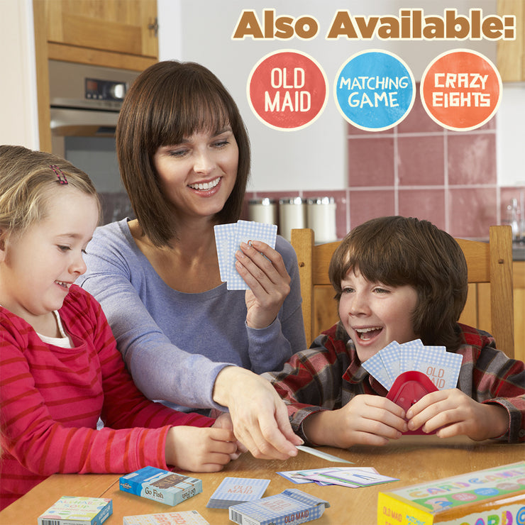 mom with son and daughter playing go fish at a table