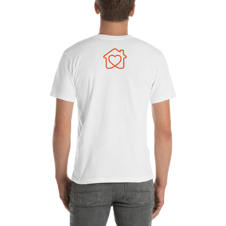 man standing back facing with white shirt on with orange eden shack logo
