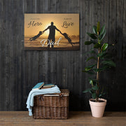 large sunset canvas on wooden style wall with green plant and stool
