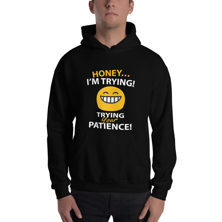 man in a black sweatshirt text reads honey i'm trying - trying your patience