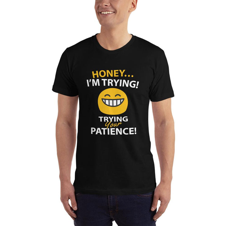 man in a black t-shirt funny text reads honey i'm trying - trying your patience