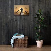 medium sized sunset canvas on wooden style wall with green plant and stool