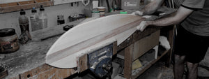 Hand crafted timber skateboard being hand sanded.