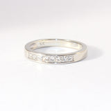 14kt Wedding Band with 8 Princess Cut Diamonds