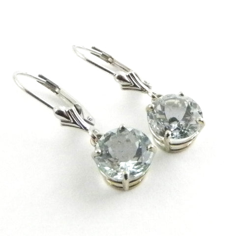 Shining round aquamarines hanging from 14kt white gold leverback earrings.