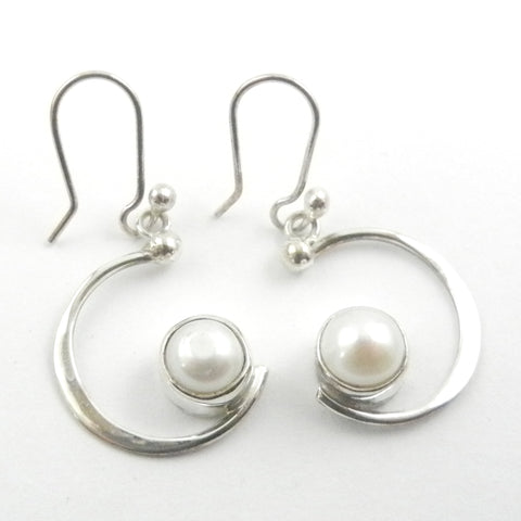 Custom made silver dangle earrings with a silver crescent and a white pearl like a full moon.