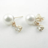 White pearls with a diamond dangle are a classic combination for these 14 kt yellow gold custom design stud earrings.