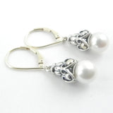 This custom jewelry features an intricate silver and gold dangle with akoya white pearls on gold leaverback earrings.