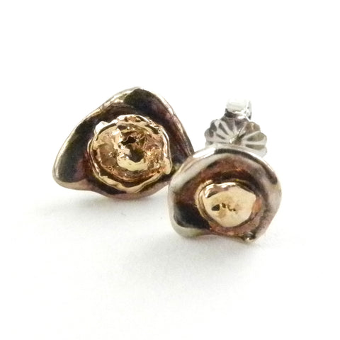 Custom design stud earrings with free-form 'puddles' of 14K gold and sterling silver