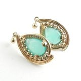 Custom design gold earrings for women feature pear shaped peruvian opal earrings set in 14kt yellow gold.